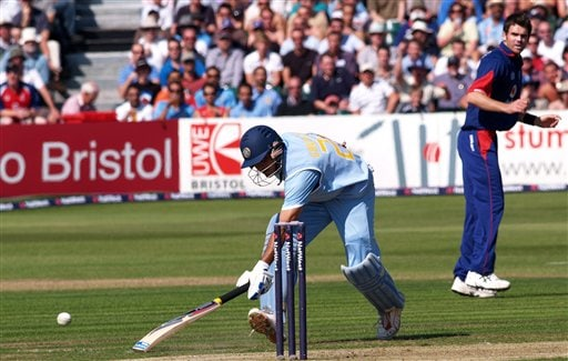 India's Sourav Ganguly, left, gets back to his crease after a ball from England's James Anderson, right, missed the stumps during the 2nd one-day cricket match series between England, and India, in Bristol, England on Friday.