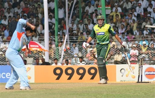 Sachin Tendulkar, left, celebrates the dismissal of Pakistan's Shahid Afridi during their first one day international cricket match in Gauhati, India, Monday, Nov. 5, 2007.