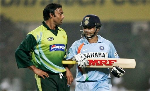 Sachin Tendulkar, right, shares a lighter moment with Pakistan's Shoaib Akhtar during the fourth one-day international match in Gwalior on Thursday, Nov. 15, 2007.