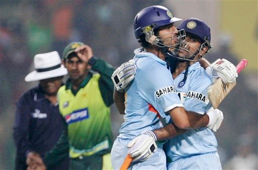 Yuvraj Singh, right and Mahendra Singh Dhoni, second from right, celebrate after India beat Pakistan by 6 wickets in the fourth one-day international match in Gwalior on Thursday, Nov. 15, 2007.