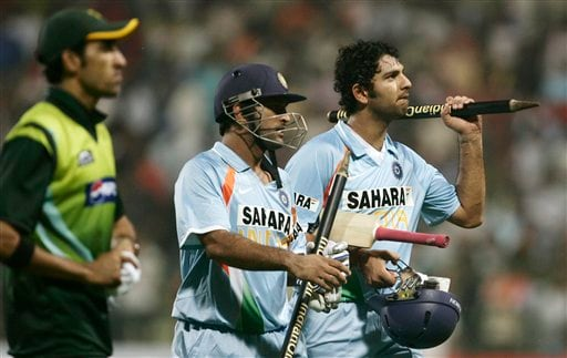 Yuvraj Singh, right and Mahendra Singh Dhoni, center, celebrate after India beat Pakistan by 6 wickets in the fourth one-day international cricket match in Gwalior on Thursday, Nov. 15, 2007.