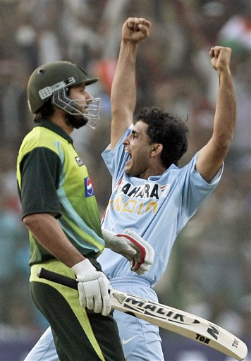 Sourav Ganguly, right, celebrates the dismissal of Paksitan's Shahid Afridi, left, during the fourth one-day international cricket match in Gwalior, India Thursday Nov. 15, 2007.