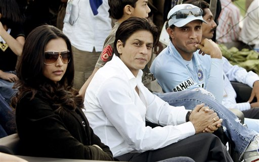 Bollywood actors Deepika Padukone, left, Shahrukh Khan, center, and Indian cricket player Sourav Ganguly watch the fifth one-day internationalatch in Jaipur on Sunday, Nov 18, 2007.