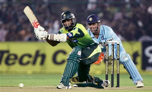 Pakistan's Mohammad Yousuf, left, plays a shot as Mahendra Singh Dhoni looks on during the fifth one-day international cricket match in Jaipur on Sunday, Nov 18, 2007.