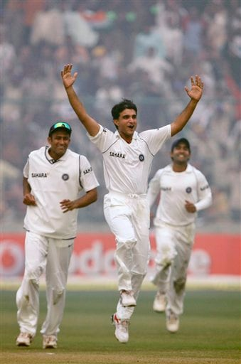 Sourav Ganguly, center, celebrates after he dismissed Pakistan's Mohammad Yousuf, unseen, in the first Test match in New Delhi on Thursday, Nov 22, 2007.