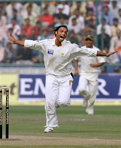 Pakistan's Shoaib Akhtar celebrates the dismissal of India's Wasim Jaffer, unseen, on the second day of the first Test match, in New Delhi on Friday, Nov 23, 2007.