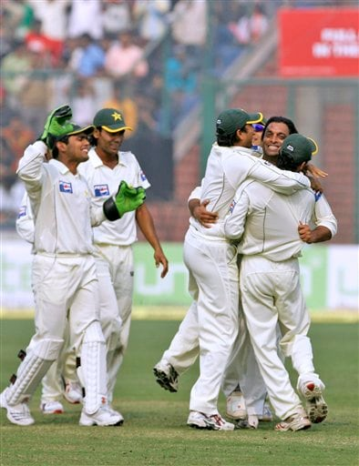 Pakistan's Shoaib Akhtar, second right, celebrates the dismissal of India's Wasim Jaffer, unseen, on the second day of the first Test match, in New Delhi on Friday, Nov 23, 2007.