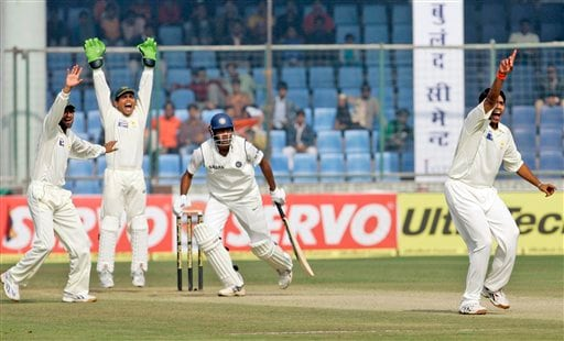 Pakistan's bowler Dinesh Kanaria, right, and team members appeal for the dismissal of Indian captain Anil Kumble, center, during the third day of the first Test match between India and Pakistan in New Delhi on Saturday, Nov 24, 2007.