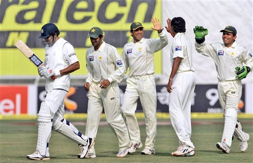 Pakistan's team members celebrate the last Indian wicket of Zaheer Khan, left, the third day of the first Test match between India and Pakistan in New Delhi on Saturday, Nov 24, 2007.