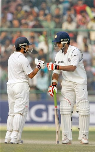 India's Sourav Ganguly, right, and Sachin Tendulkar share a moment during their partnership during the fourth day of the first cricket test match between India and Pakistan
