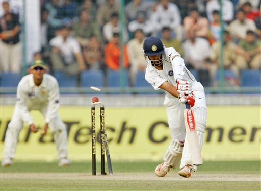India's Rahul Dravid is bowled by Shoaib Akhtar, unseen, during the fourth day of the first cricket test match between India and Pakistan