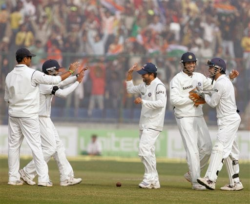 Members of the Indian team celebrate after Sachin Tendulkar, third left, and wicket keeper Mahinder Singh Dhoni run out Pakistan's Dinesh Kanaria, unseen, during the fourth day of the first Test between India and Pakistan in New Delhi on Sunday, Nov 25, 2007.