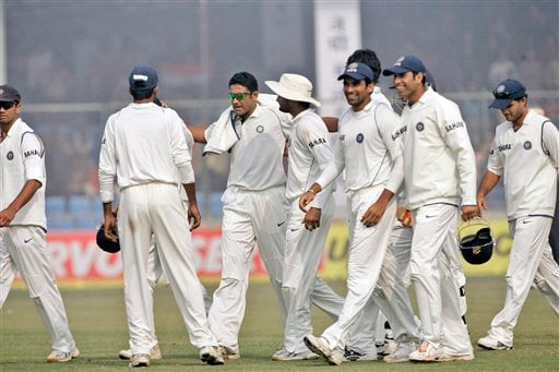 Indian captain Anil Kumble, third left, and members of the Indian team celebrate after the fall of the last Pakistan wicket during the fourth day of the first Test match between India and Pakistan, in New Delhi on Sunday, Nov. 25, 2007.