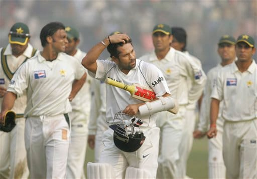 Sachin Tendulkar, foreground, walks ahead of the Pakistan team after India won the first Test match in New Delhi on Monday, Nov 26, 2007.