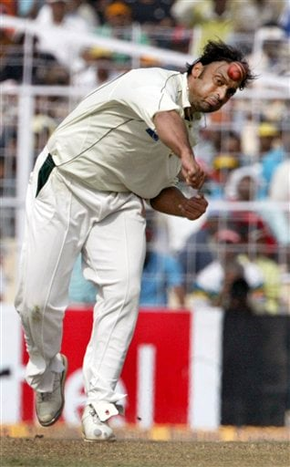 Pakistan's Shoaib Akhtar bowls against India's Sachin Tendulkar, unseen, during the first day of the second test match between India and Pakistan in Kolkata.