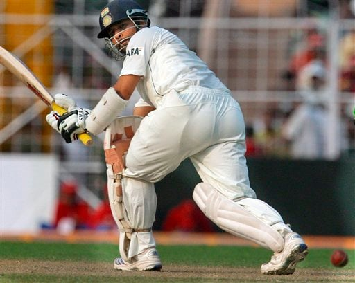 India's Sachin Tendulkar hits a shot during the first day of the second cricket test match between India and Pakistan in Kolkata.
