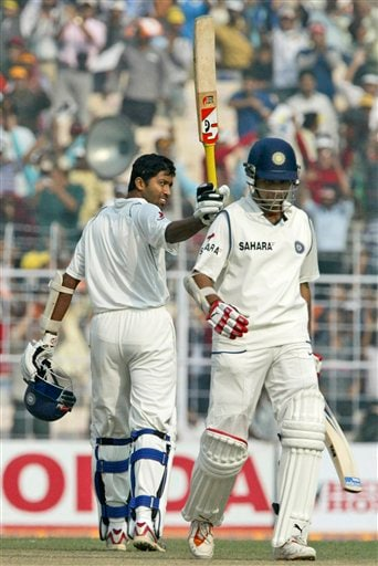 Wasim Jaffer, left, acknowledges the crowd after scoring a double century against Pakistan during the second day of second Test match in Kolkata on Saturday, December 1, 2007. Indian cricketer Sourav Ganguly also seen at right. India leads 1-0 in three Test series.