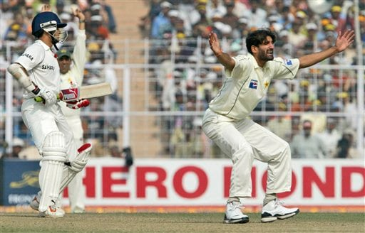 Sohail Tanvir, right, makes an unsuccessful appeal against India's Sourav Ganguly, left, during the second day of the second Test match between India and Pakistan in Kolkata on Saturday, December 1, 2007.