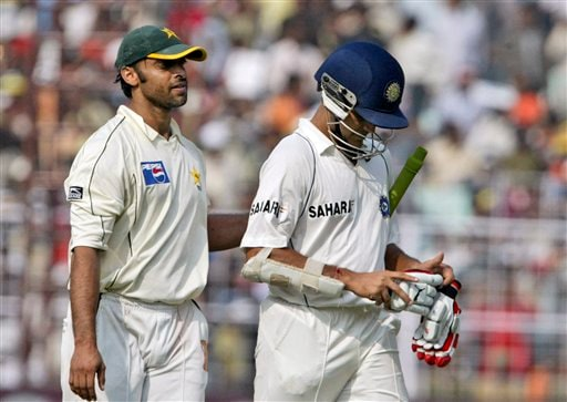 Sourav Ganguly, right, walks out after his dismissal as Pakistan's Shoaib Akhtar pats him, during the second day of second Test match between India and Pakistan in Kolkata on Saturday, December 1, 2007.