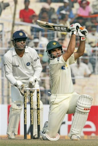 Pakistan's Misbah-ul-Haq plays a shot as Indian wicket keeper Mahendra Dhoni reacts during the fourth day of second Test at Kolkata on Monday, Dec 3, 2007. India leads 1-0 in the three Test series.