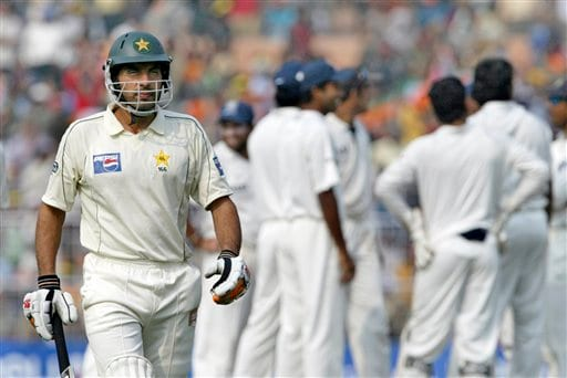 Pakistan's Misbah-ul-Haq walks out after his dismissal as Indian cricketers celebrate in the backdrop on the fifth day of second Test match in Kolkata on Tuesday, Dec 4, 2007.