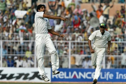 Munaf Patel jumps in the air as he celebrates the dismissal of Pakistan's Misbah-ul-Haq, unseen, on the fifth day of second Test match in Kolkata on Tuesday, Dec 4, 2007. Indian cricket captain Anil Kumble is at right.