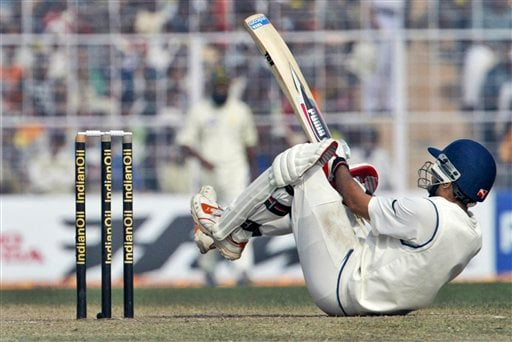 Sourav Ganguly falls on the ground while trying to avoid a delivery from Pakistan's Sohaib Akhtar, unseen, during the fifth day of second Test match in Kolkata on Tuesday, Dec 4, 2007.
