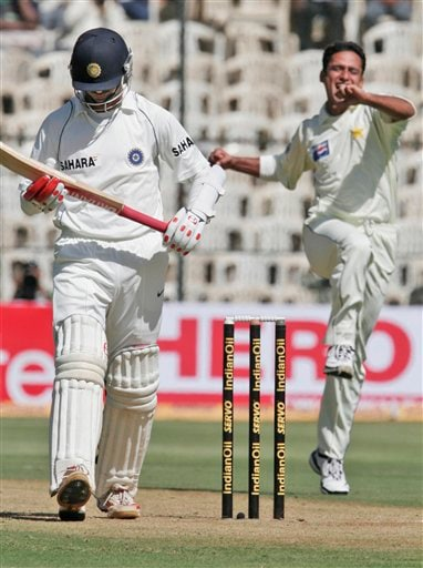Pakistan's Yasir Arafat, right, celebrates after the dismissal of India's Rahul Dravid, left, on the first day of their third and final Test in Bangalore on Saturday, Dec 8, 2007. India leads the series 1-0.