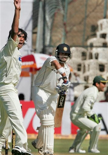 Pakistan's Mohammed Sami, left, appeals successfully for a wicket of India's Gautam Gambhir, center, on the first day of their third and final Test in Bangalore on Saturday, Dec 8, 2007. India leads the series 1-0.