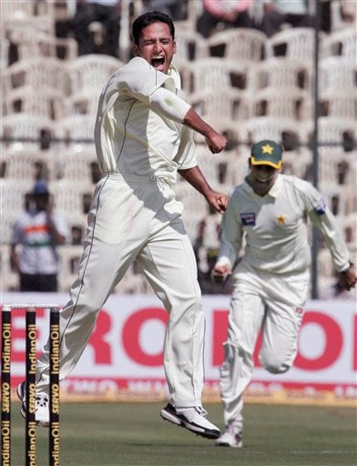 Pakistan's Yasir Arafat celebrates the dismissal of India's Rahul Dravid, unseen, on the first day of their third and final Test in Bangalore on Saturday, Dec 8, 2007. India leads the series 1-0.