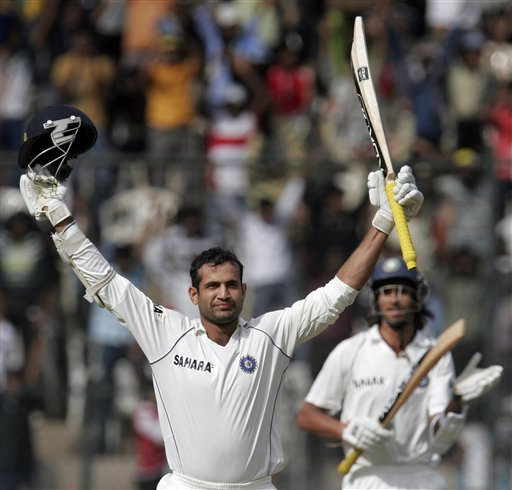 Irfan Pathan gestures to the crowd as he celebrates scoring a century during the second day of the final Test against Pakistan at Chinnaswamy Stadium in Bangalore on Sunday, Dec 9, 2007. India leads the series 1-0.