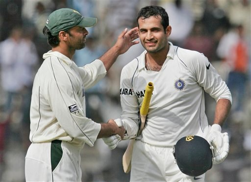 Pakistan's Shoaib Akhtar, left, greets India's Irfan Pathan on scoring a century during the second day of the last Test at Chinnaswamy Stadium in Bangalore on Sunday, Dec 9, 2007. India leads the series 1-0.
