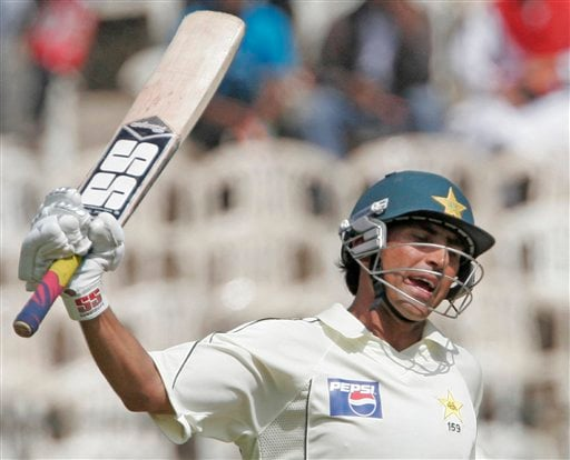 Pakistan team captain Younis Khan celebrates after scoring fifty runs during the third day of their final Test in Bangalore Monday, Dec 10, 2007. India leads the series 1-0.