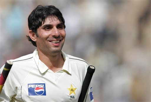 Pakistan's Misbah-ul-Haq smiles as he leaves the ground, after scoring a century during the fourth day of the final Test match against India in Bangalore on Tuesday, Dec 11, 2007. India leads the series 1-0.