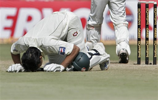 Pakistan's Misbah-ul-Haq bows his head to touch the ground to celebrate scoring a century during the fourth day of the final Test match against India in Bangalore on Tuesday, Dec 11, 2007. India leads the series 1-0.