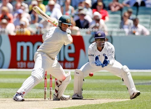 Matthew Hayden at bat as Indian wicketkeeper MS Dhoni looks on during the first day of the first cricket Test match against Australia at the Melbourne Cricket Ground in Melbourne on Wednesday, December. 26, 2007.