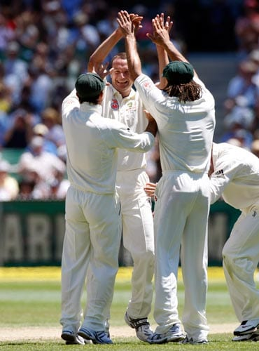 Stuart Clark, center, celebrates his wicket of Rahul Dravid during the second day of their first Test match between Australia and India at the Melbourne Cricket Ground on Thursday, December 27, 2007.
