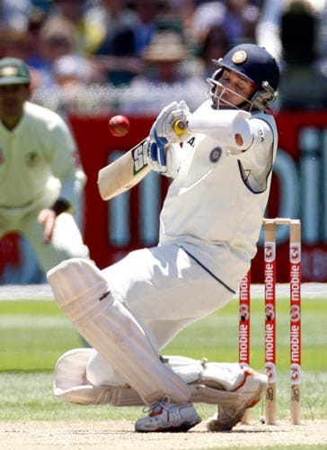 VVS Laxman gets hit by a ball from Australia's Brett Lee as he was caught out by Ricky Ponting during the second day of their first Test cricket match at the Melbourne Cricket Ground in Melbourne on Thursday, December 27, 2007.