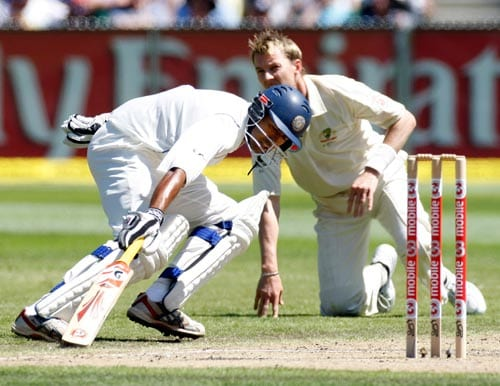 Wasim Jaffer, left, and Australia's Brett Lee in action during the second day of their first Test match at the Melbourne Cricket Ground in Melbourne on Thursday, December 27, 2007.
