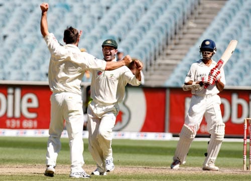 Brad Hogg, left, and Ricky Ponting celebrate after taking the wicket of Sourav Ganguly, right, during the fourth day of their first Test match at the Melbourne Cricket Ground on Saturday, December 29, 2007.