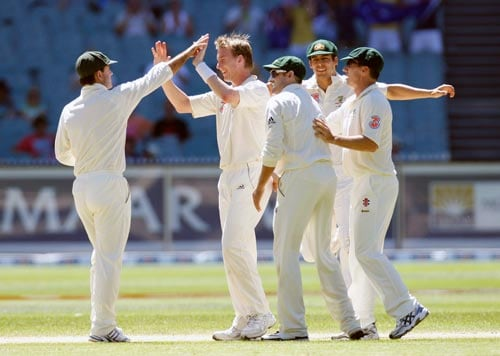 Brett Lee, center, celebrates with the team-mates after dismissing Wasim Jaffer during the fourth day of their first Test match at the Melbourne Cricket Ground on Saturday, December 29, 2007.