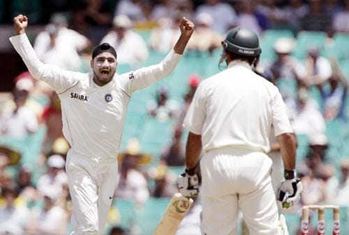 Harbhajan Singh, left, celebrates after dismissing the Australian captain Ricky Ponting, right, LBW for 55 runs at the Sydney Cricket Ground on Wednesday, January 2, 2008, on the first day of their second cricket Test.