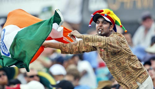 An Indian supporter waves a national flag on day two of the second cricket Test against Australia in Sydney on Thursday, January 3, 2008.