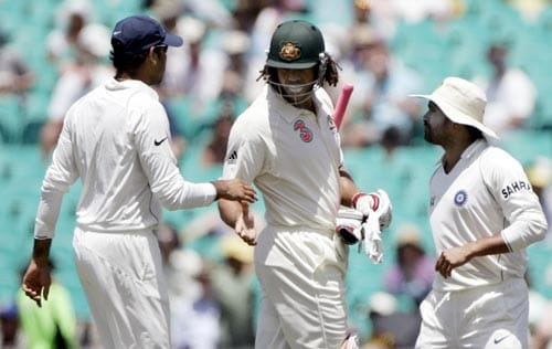 Sachin Tendulkar, right, and Rudra Singh, left, congratulate Andrew Symonds, center, at the end of Australia's first innings at the Sydney Cricket Ground on Thursday, January 3, 2008, on the second day of their second cricket Test. Symonds was 162 not out.