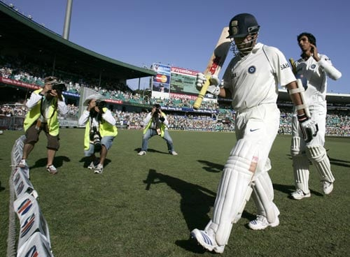 Sachin Tendulkar, second from right, waves his bat as he walks off with a score of 154 not out at the end of India's first innings against Australia at the Sydney Cricket Ground on Friday, January 4, 2008, on the third day of their second cricket Test. India made 532 in reply to Australia's 463 in their first innings.