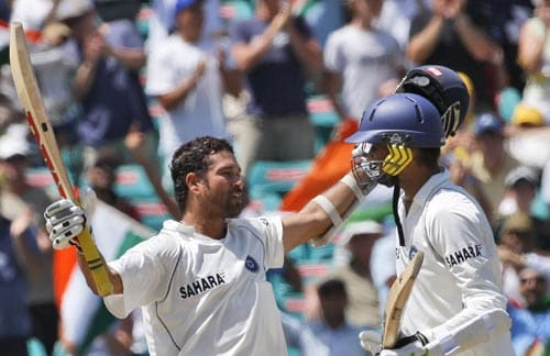 Sachin Tendulkar, left, celebrates his century with Harbhajan Singh on day three of the second Test against Australia in Sydney on Friday, January 4, 2008.