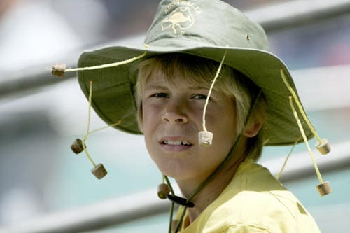 A young cricket fan wears an iconic Australian style hat with corks to shoo flies while watching India and Australia at the Sydney Cricket Ground on Friday, January 4, 2008, on the third day of their second cricket Test.