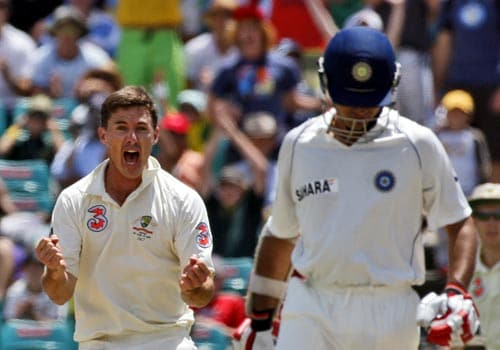 Brad Hogg, left, celebrates taking the wicket of Sourav Ganguly, right, for 67 runs on day three of the second Test in Sydney on Friday, January 4, 2008.