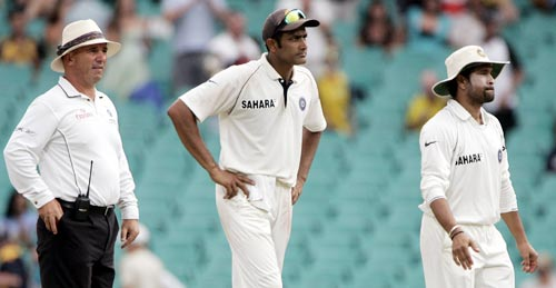 Anil Kumble, center, and Sachin Tendulkar, right, react after they were told by umpire Mark Benson, left, that play is stopped because of bad light at the Sydney Cricket Ground on Saturday, January 5, 2008, on the fourth day of their second cricket Test against Australia. At stumps Australia are 282 for 4 in their second innings.