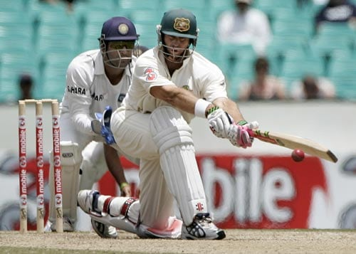 Matthew Hayden, right, sweeps a delivery from Anil Kumble as wicketkeeper Mahendra Dhoni at the Sydney Cricket Ground on Saturday, January 5, 2008, on the fourth day of their second cricket Test.